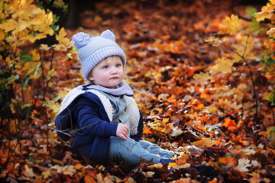 baby boy sitting in autumn leaves in Nottingham family photography