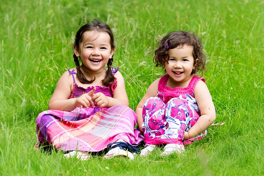 family photography nottingham sisters laughing at park