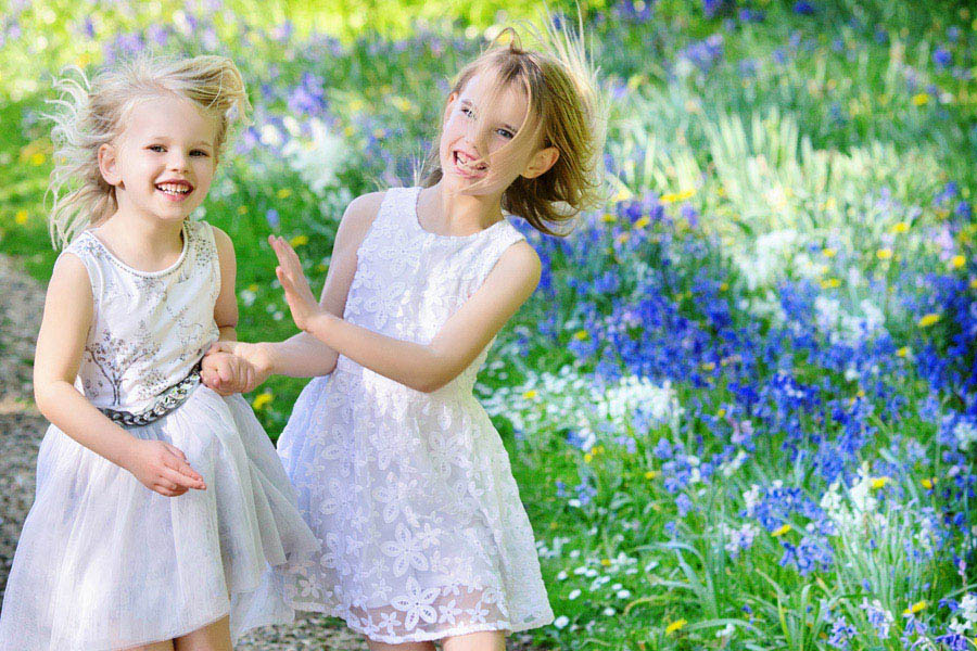 family photography nottingham sisters laughing in bluebells fields