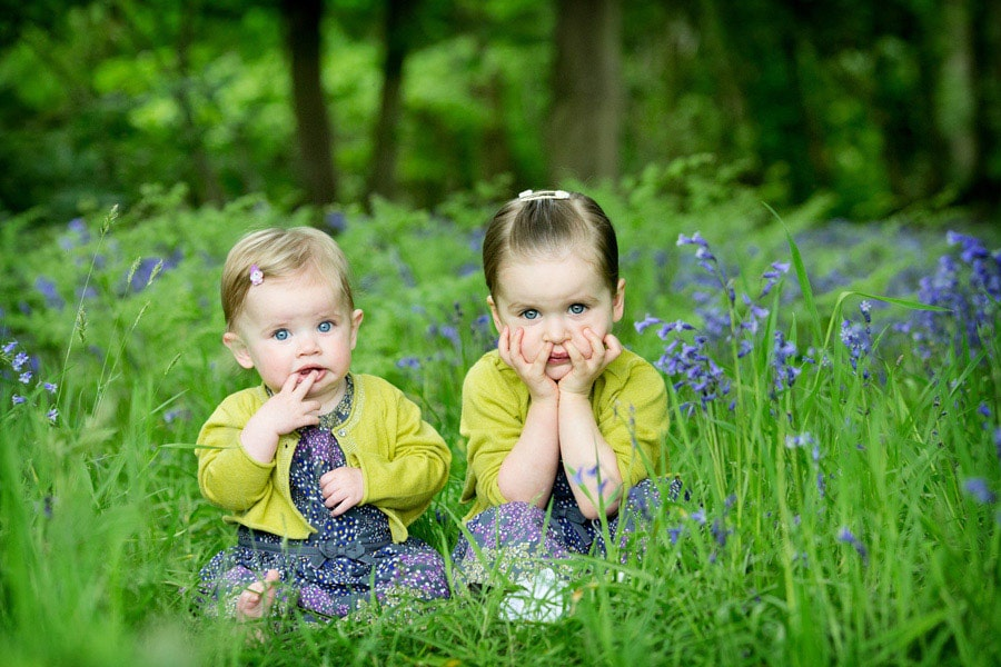 family photography nottingham sisters sitting in bluebell gardens