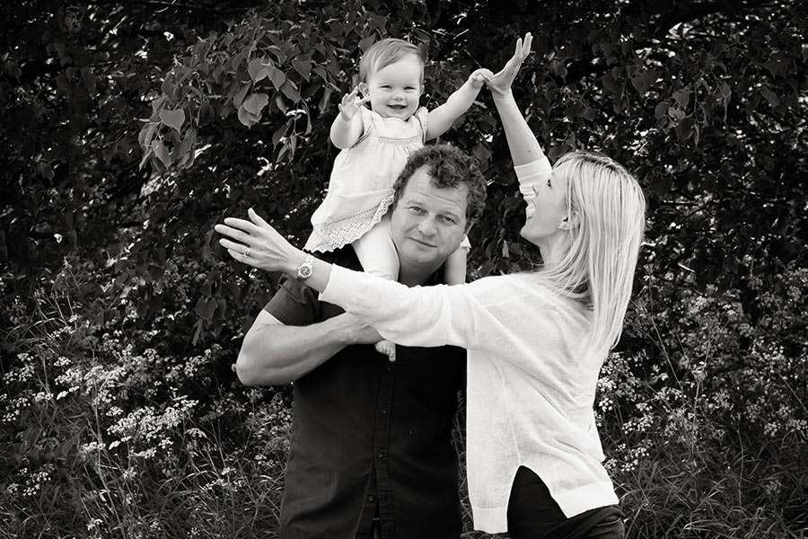 mum dad and young girl on dad's shoulders nottingham family photography