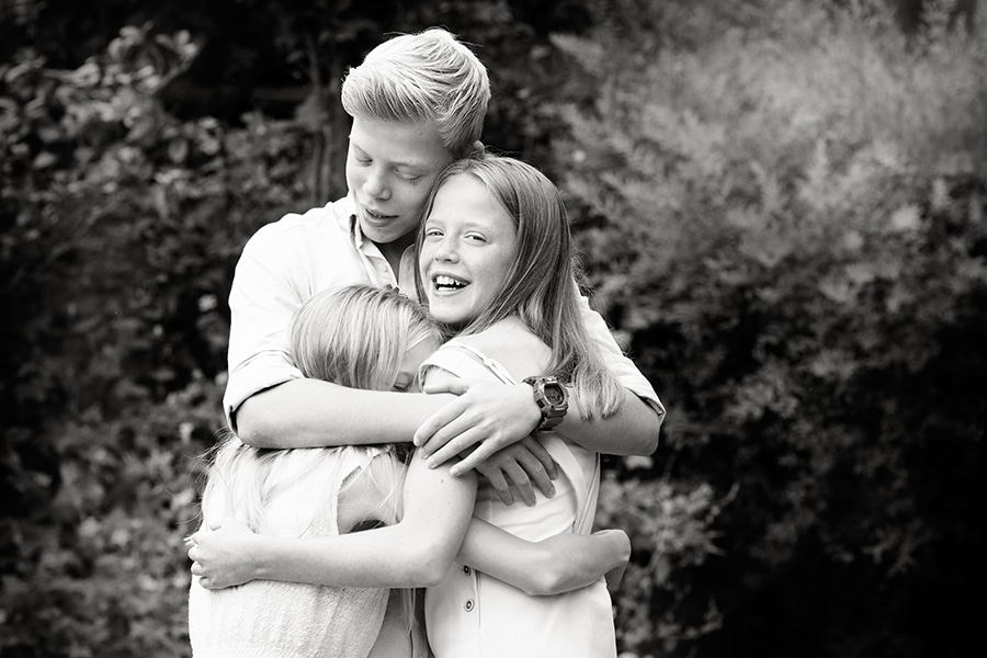 brother hugging sisters family photography nottingham