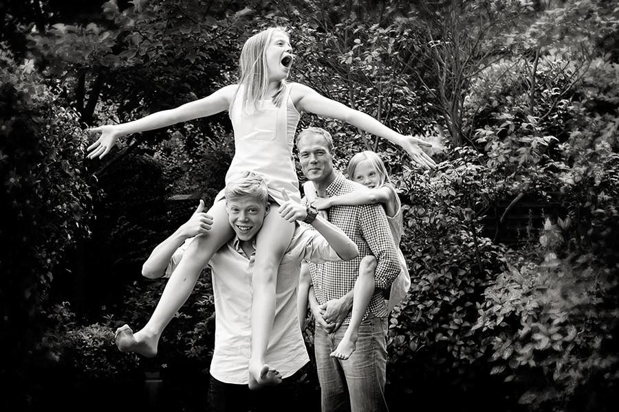 family photography nottingham family giving piggy backs