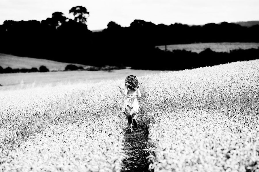 family photography nottingham girl running through cornfield