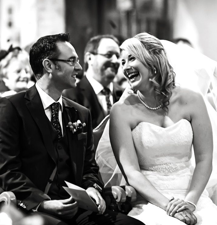 uk wedding photography bride and groom smiling in church
