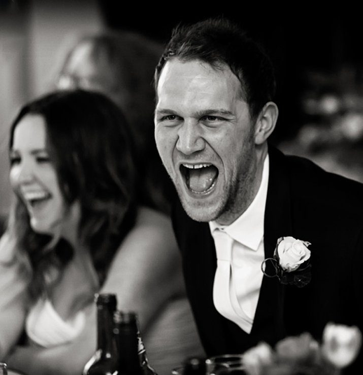 bride and groom laughing in speeches wedding photographer uk
